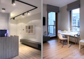 W mieszkaniu dominuje industrialne, techniczne oświetlenie szynowe w kolorze czarnym. Świetlenie współgra z czarną cegłą i wyróżnia  się na białym suficie.