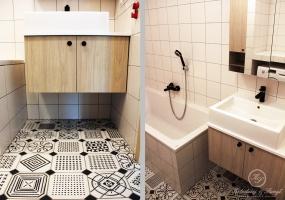 W łazience z wanną dominują białe kwadratowe płytki w połączeniu z  szarą fugą.