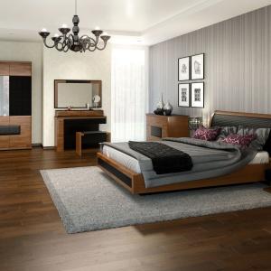 Sypialnia Verano jest elegancka. Łączy w sobie barwy drewna oraz stylowej czerni, którą umieszczono na wezgłowiu. Fot. Mebin.