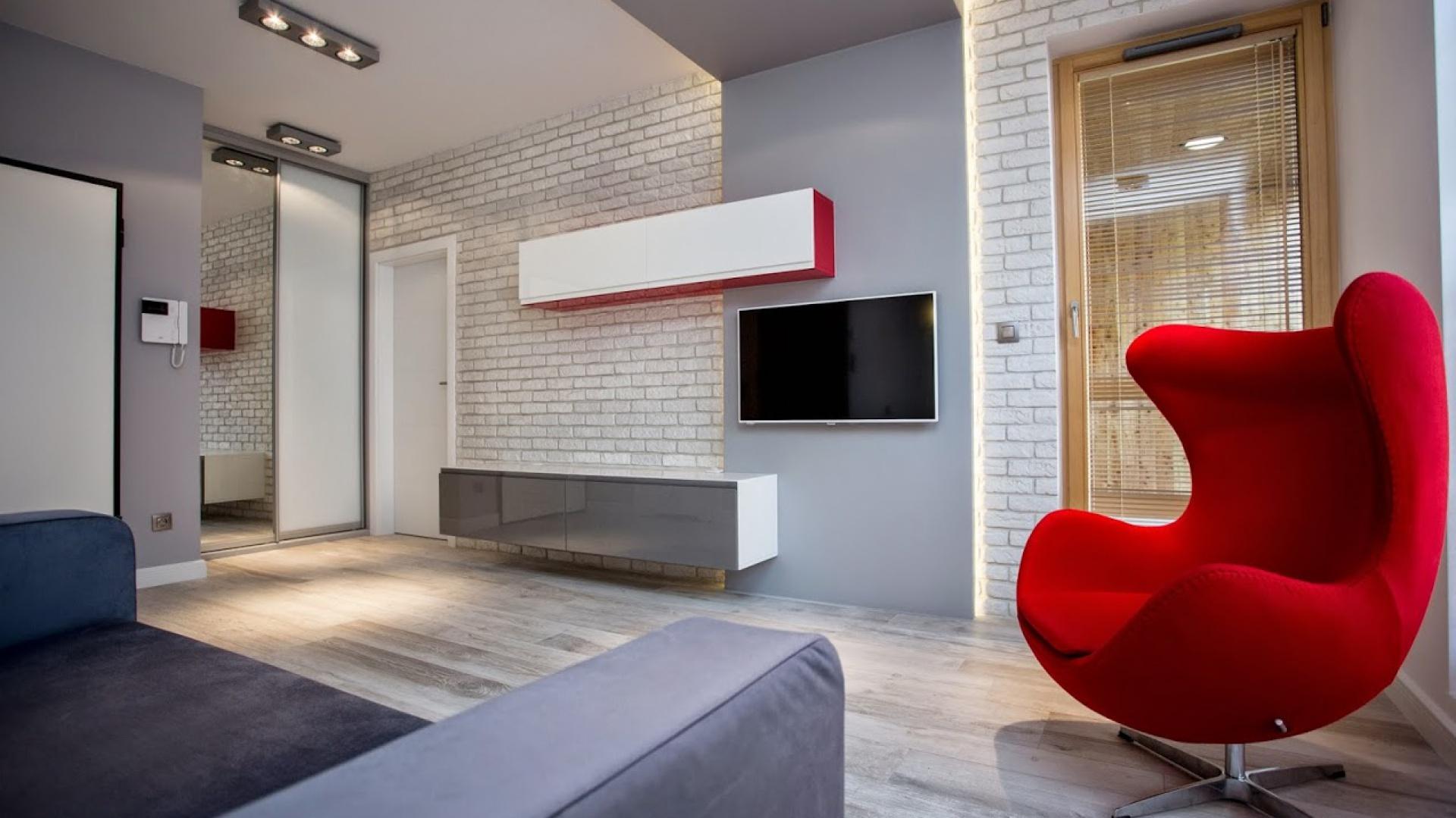 Nowoczesny, minimalistyczny salon w małym mieszkaniu. Realizacja: Łukasz Siemieniec, Lurvig Projektowanie Wnętrz. Fot. Archiconnect.pl