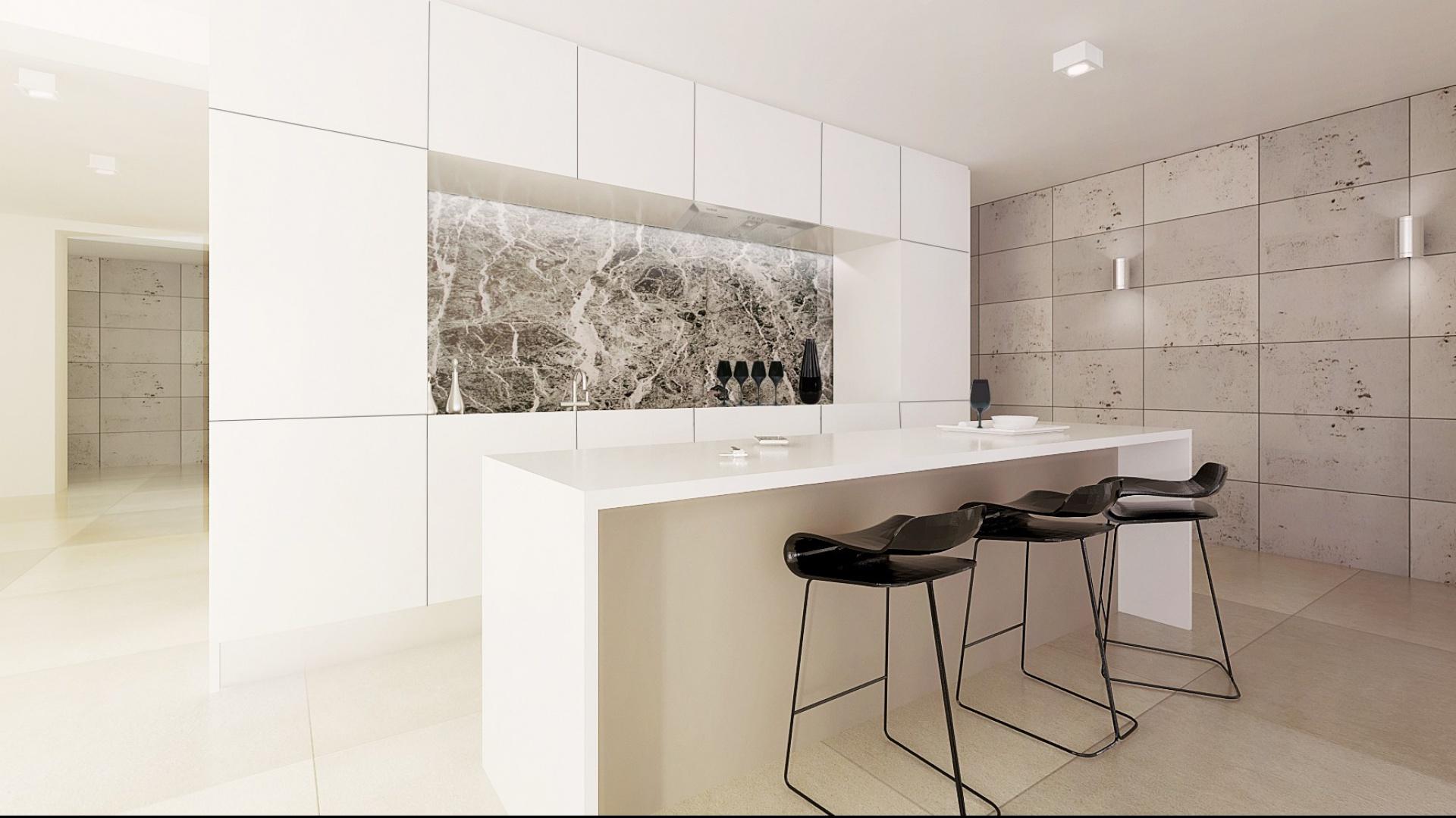 Dom jednorodzinny pod Gdańskiem zaprojektowany został w połączeniu nowoczesnej elegancji z minimalizmem. Jednocześnie miały to być wnętrza ciepłe, z zastosowaniem naturalnych materiałów takich jak kamień i drewno. Projekt: Beata Albrecht, Ajot Pracownia Projektowa. Fot. Archiconnect.pl