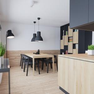 Większość ścian w mieszkaniu jest biała, tworząc czyste tło dla mebli i wyposażenia. Wyjątek stanowią ściana nad blatem w kuchni, wykończona konglomeratem, druga kuchenna ściana pokryta farbą tablicową oraz wnętrze gabinetu przy salonie. Projekt i wizualizacje: 081 Architekci.