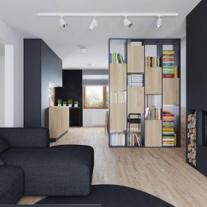 Oprócz biblioteczki, funkcjonującej jako element działowy, granicę pomiędzy salonem, a kuchnią i jadalnią wyznacza listwa z oświetleniem. Projekt i wizualizacje: 081 Architekci.