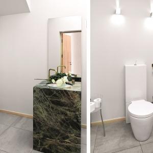 Biała łazienka z umywalka z zielonego marmuru. Projekt: Alina Grzybowska, Konstanty Jeżewski. Fot. Bartosz Jarosz.