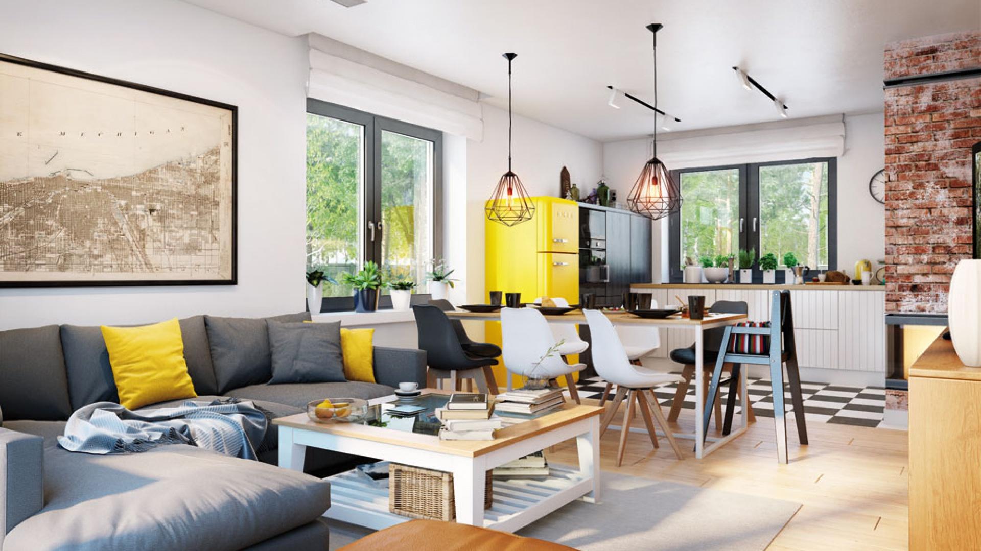 W jadalni ustawiono prosty stół na surowej, metalowej podstawie z drewnianym blatem i krzesła doskonale nawiązującymi do kuchennej podłogi. Takie zestaw komfortowo łączy się z bardziej klasyczną strefą dzienną. Na wizualizacji wnętrza Domu w zielistkach 5 Archon+ znajdują się: stół Denver, krzesła Norden Cross, lampy Matrix, stolik Maxime, kominek MBZ, narożnik Biki, dostępne w sklepie archonhome.pl