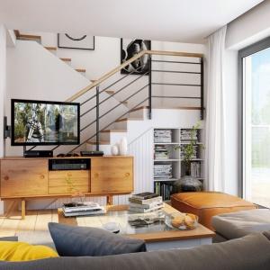 Strefa wypoczynkowa Domu w zielistkach 5 oferuje pełen komfort domownikom, mimo dość kompaktowego wykorzystania powierzchni. Meble widoczne na wizualizacji Domu w zielistkach 5 Archon+ dostępne w sklepie archonhome.pl