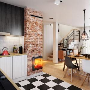 Idealnie aranżowana otwarta kuchnia spełnia wszystkie wymagania Pani domu, a łącznik między kuchnią a salonem w postaci części jadalnej jest świetnym pomysłem przy mniejszym metrażu.
