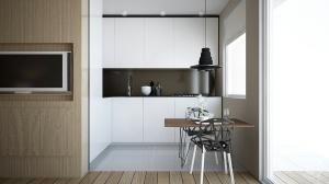 W małym pomieszczeniu efekt przestrzeni uzyskano dzięki zastosowaniu białej kolorystyki. Barwa ta przyczynia się do optycznego powiększenia pomieszczenia i nadaje mu lekkości. Wśród zalet aranżacji warto wspomnieć o ergonomicznym wykorzystaniu przestrzeni. Dzięki odpowiednio zaprojektowanej zabudowie w małej kuchni udało się pomieścić wszystkie sprzęty, zaplanowano także miejsce na stół i krzesła o industrialnym charakterze, do których nawiązuje lampa zaprojektowana w podobnym stylu.