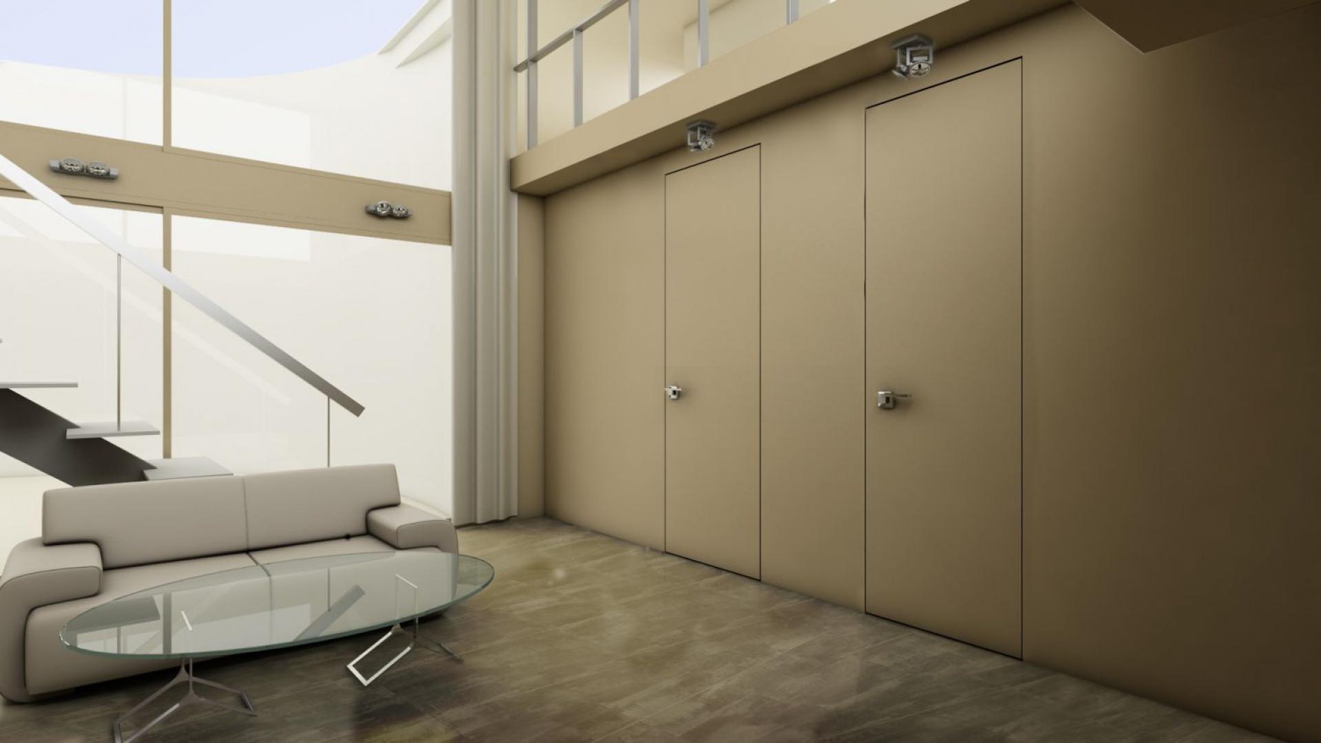 Chowające się w ścianie drzwi to idealne rozwiązanie do minimalistycznych wnętrz. Fot. PIU Design.