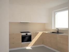 Kuchnia w wersji minimalistycznej z materiałami o ciepłej barwie