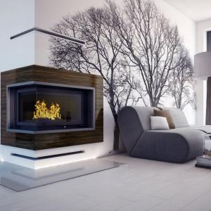 Narożny kominek w otwartej strefie dziennej pozwala podziwiać płonący ogień z różnych miejsc w domu. Fot. kratki.pl Marek Bal, kominek Oliwia.