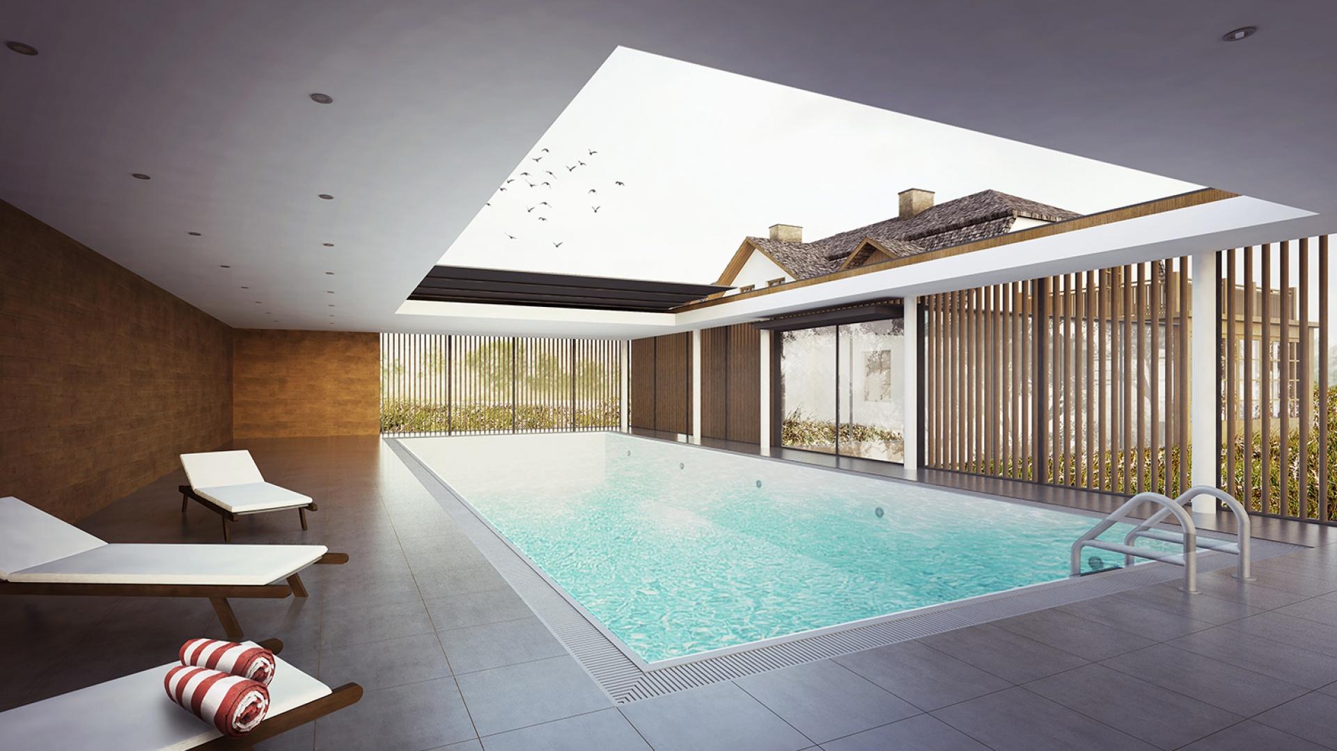 Prosta, minimalistyczna forma z płaskim, otwieranym dachem nawiązuje wysokością do okapów istniejącego obiektu. Fot. BXBstudio
