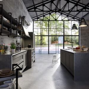 Kolejna inspiracja od włoskiej marki Aran: w typowo pofabrycznym wnętrzu urządzono kuchnię wpisującą się w jego klimat. Meble są szare, z obudową imitującą beton, który widać również na ścianach kuchni. Fot. Aran Cucine, kuchnia Bellagio