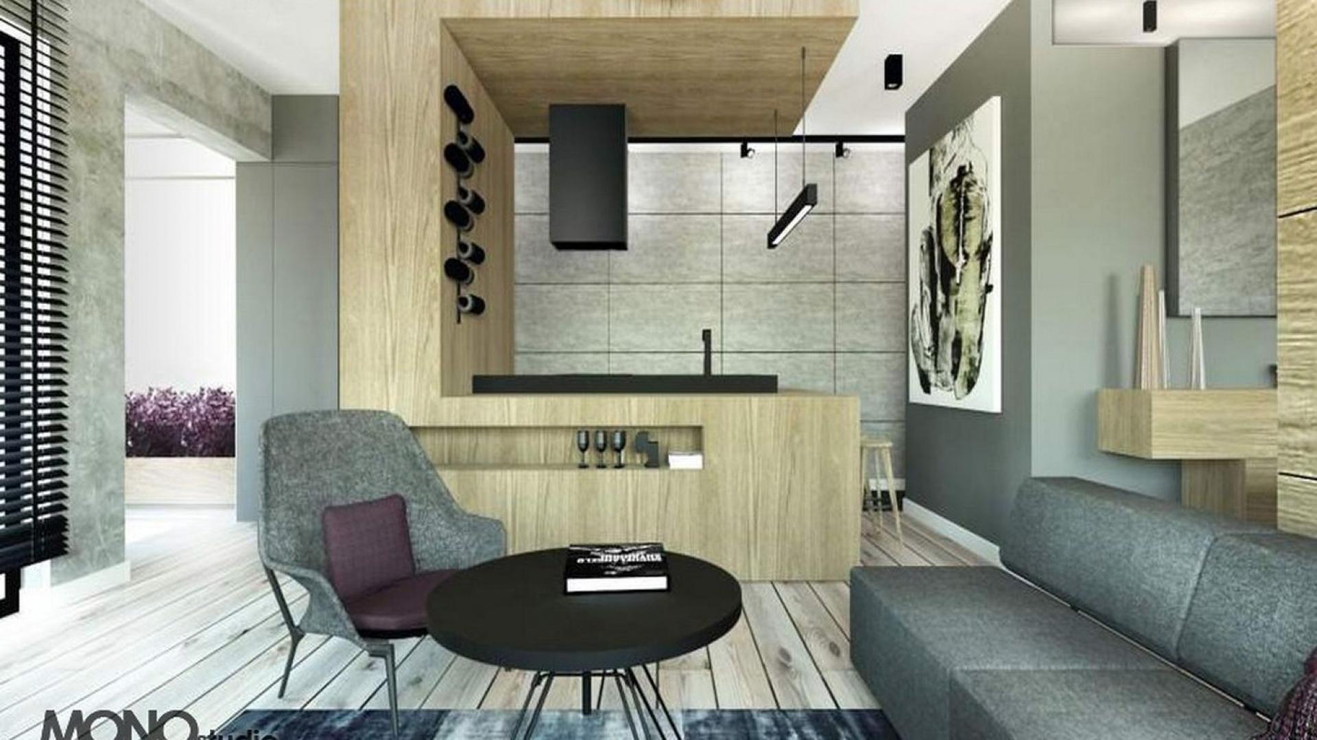 Modernistyczny aneks kuchenny jako drewniany akcent w betonowej formie. Projekt MONOstudio. Fot. Archiconnect.pl
