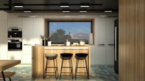 Wyspa w kuchni stanowi miejsce do gotowania. Nie chcieliśmy zasłaniać pięknego widoku z okna, więc zamiast powieszać nad nią okap, zastosowaliśmy płytę grzewczą z wbudowanym pochłaniaczem.