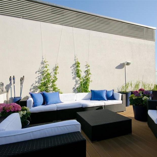 Taras - pomysły projektantów wnętrz na relaksującą, przydomową przestrzeń