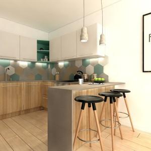 Jeżeli mamy wystarczająco dużo miejsca w kuchni, to zamontujmy w niej półwysep, który będzie służył jako miejsce do spożywania posiłków. Fot. Wnętrzomania