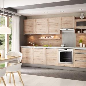 Kuchnia na jedną ścianę pozwala wygospodarować miejsce na wygodny kącik jadalniany. To on oddziela wówczas strefę kuchenną od salonu. Fot. KAM
