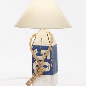 Niezwykła oryginalna lampa, która przywodzi na myśl swoją formą... plażowe boje. Kolory nawiązują do stylu marynistycznego. Fot. Inne Meble/Mare-me