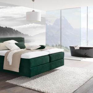 Pochodzące z nowej kolekcji Design Collection tapicerowane łóżko ma piękny, soczyście zielony kolor. Fot. Huelsta