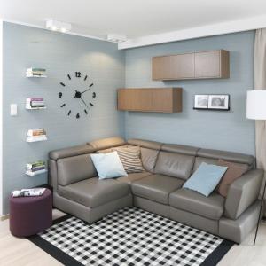 Urządzony w stylu inspirowanym modernizmem salon ma na wyposażeniu szary narożnik. Projekt: Joanna Morkowska-Saj. Fot. Bartosz Jarosz