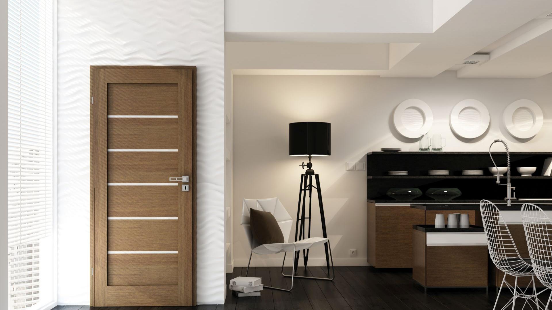 Tradycyjne, masywne drzwi doskonale prezentują się w klasycznie urządzonych wnętrzach. Kolekcja Domino wyróżnia się nie tylko jakością, która zapewnia trwałość na lata, ale także ponadczasową stylistyką. Fot. Invado