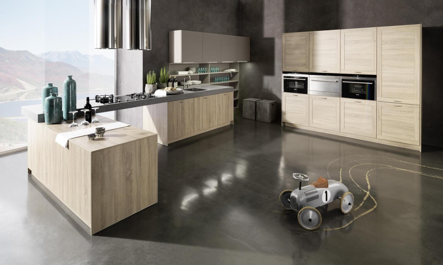 W kuchni Cosmo króluje skalny dąb, przełamany miękkim lakierem w kolorze cappucino. Całości dopełnia solidny blat o grubości 10 cm. Rational Einbauküchen