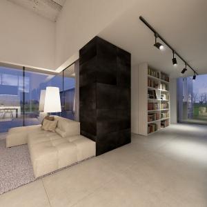 Dom za murem kryje w sobie niezwykle otwarte wnętrze.
