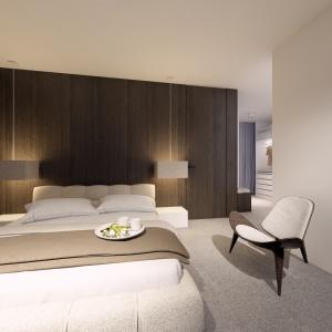 Spokojne barwy w sypialnia zapewniają komfortowy wypoczynek.