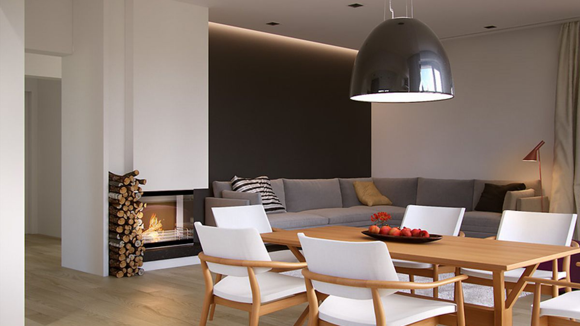 Kominek z czarną obudową doskonale wpisuje się w charakter wnętrza. Ulokowano go na ścianie łączącej salon z korytarzem, dzięki czemu jest widoczny z każdego punktu salonu i jadalni. Fot. MTM Styl