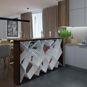 Kuchnię zaplanowano jako otwartą na jadalnię i salon. Taka organizacja przestrzeni pozwala na wkomponowanie efektownego elementu działowego - kuchennego baru z oryginalnym ażurowym przepierzeniem. Proj. Nowik, Fot. Archetyp