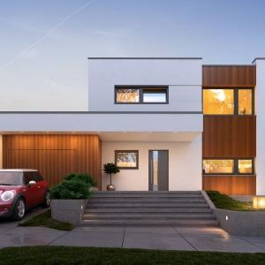 Biel i drewno to elementy przewodnie elewacji domu. Kontynuacja tej stylistyki występuje również we wnętrzu. Proj. Nowik, Fot. Archetyp