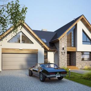 Dom składa się z połączonych ze sobą dwóch brył: części mieszkalnej i dwustanowiskowego garażu. Obie części wieńczy dwuspadowy dach. Projekt: Tris II, Fot. Dobre Domy