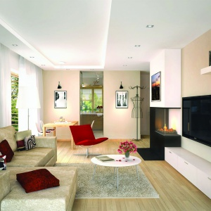 Strefa dzienna to salon połączony z jadalnią. Niewielką przestrzeń optycznie powiększono stosując biały kolor na ścianach i suficie. Fot. Pracownia Projektowa Archipelag