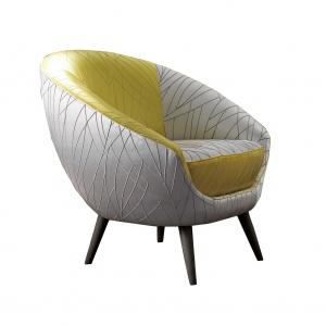 Fotel TONDA ma obły kształt, który doskonale otula osobę w nim siedzącą. Różnorodne zestawienie tkanin sprawia, że elegancki i oryginalny. Na zamówienie. Fot. Softhouse