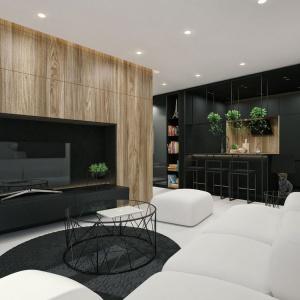 Strefa telewizyjna zaprojektowana w drewnie z wyraźnym usłojeniem. Fot. IDWhite