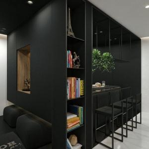 Największe wrażenie w mieszkaniu robi zaprojektowana w formie eleganckiego czarnego kubika kuchnia i jadalnia. Fot. IDWhite