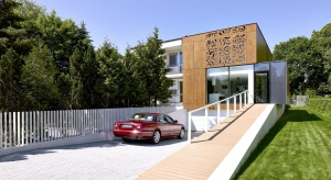 W efekcie przebudowy typowa kostka polska zmieniła się w nowoczesny dom o oryginalnej elewacji.
