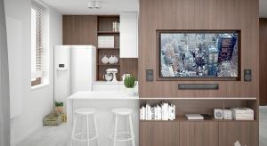 W nowoczesnym mieszkaniu panuje zimna biel, ożywiona drewnianymi elementami i paletą pastelowych barw. Stworzyliśmy przestrzeń z akcentami finezji, aby wykreować wysmakowaną kompozycje.