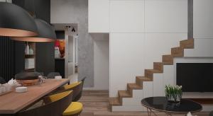 Mieszkanie zaprojektowane w stylu nowoczesnym z elementami industrialnymi, wybornie wykorzystana przestrzeń pod każdym względem i umiejętnie zagospodarowane miejsca w postaci antresoli. Widoczny kontrast barw przy surowym betonie i chłodnej kolorysty