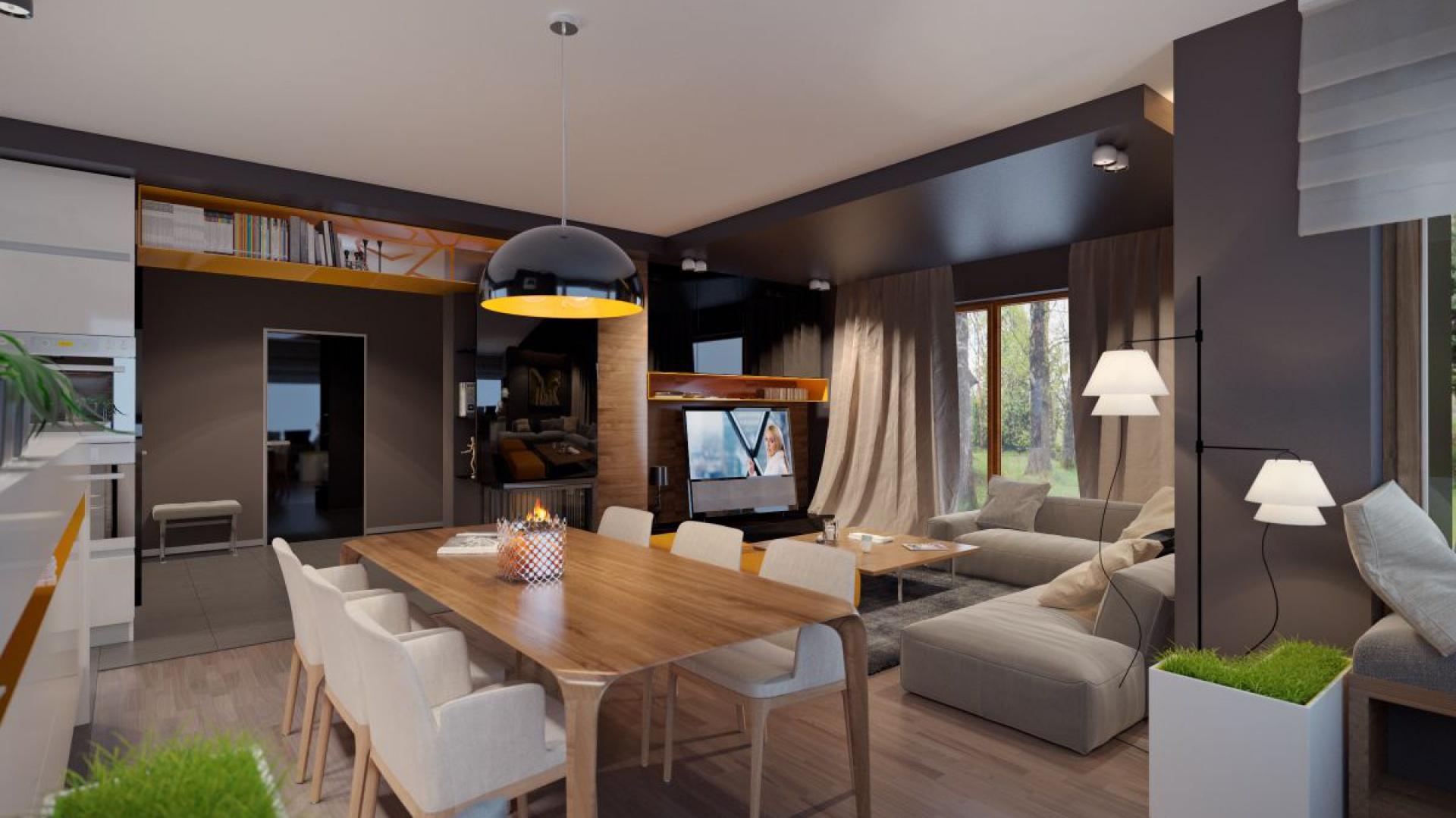 Na parterze znajduje się wspólna strefa dzienna, składająca się z salonu, częściowo otwartej kuchni oraz jadalni, która wyznacza symboliczną granicę pomiędzy kuchnią i pokojem dziennym. Fot. Archetyp