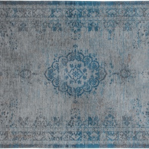 Dywan z bawełny szenilowej VINTAGE ORIENT w kolorze niebiesko-szarym dzięki procesowi szlachetnego postarzenia zyskał efekt Modern Vintage. 531 zł, Louis De Poortere