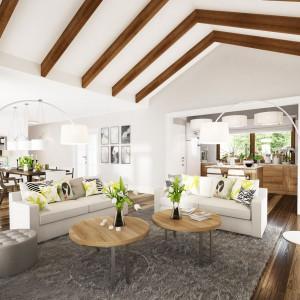Salon jest połączony z jadalnią i kuchnią, jednak układ pomieszczeń pozwala na niezależne użytkowanie każdej z tych stref. Projekt: Marcin Abramowicz, Marta Zaperty-Adamek. Fot. Dobre Domy