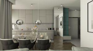 Luksusowe wnętrza w Warszawie w niewielkim mieszkaniu.Używając normalnych materiałów, udało się uzyskać atmosferę luksusu, którą czuć w luksusowej łazience, w salonie i w sypialni. Dużo luster, szyb, metalicznych akcentów, refleksów i ni