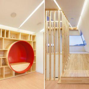 Wnętrze bardziej niż z futurystyczną stacją kosmiczną kojarzy się ze stylem skandynawskim. Ukośne ściany zewnętrzne zostały w dużym stopniu zabudowane prostymi sprzętami z klejonego drewna.
