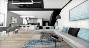 Przestronny dom z antresolą zaaranżowany w stylu nowoczesnym. Dominują tu biel i czerń, przełamane akcentami koloru niebieskiego.