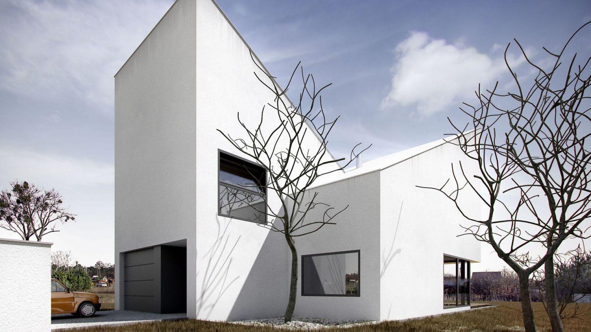 Dynamiczna forma domu nadaje mu nowoczesny charakter i odróżnia go od sąsiadujących tradycyjnych w kształcie budynków. Fot. Kluj Architekci