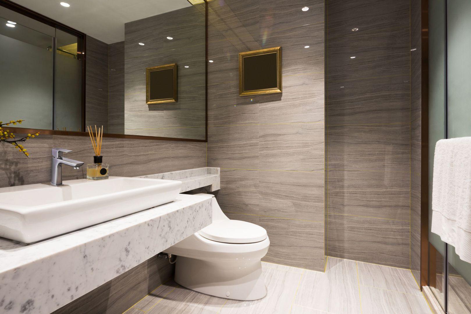 Aranżacja łazienki: stawiamy na minimalizm. Bateria umywalkowa Nyks niska. Fot. Invena.