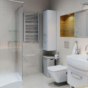 Łazienka, dzięki zastosowaniu białych płytek na całej powierzchni ścian, zyskuje na przestronności. Dom Ambrozja. Projekt: arch. Tomasz Sobieszuk. Fot. MTM Styl