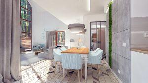 Zaraz przy kuchni jest drewniany stół na białych nogach z błękitnymi krzesłami - część jadalniana, która łączy strefę dzienną z kuchnią.